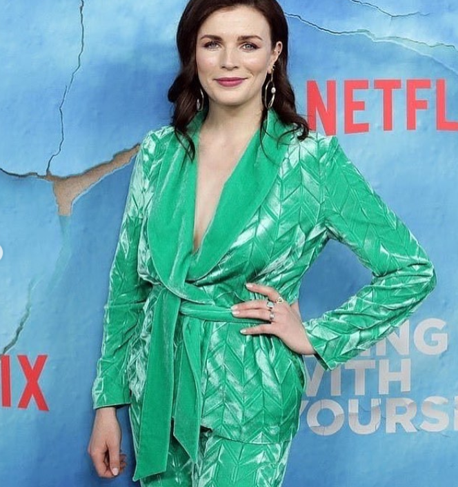 IRISH WOMAN IN HER IRISH SUIT WALKS ON A CARPET.  - November 7th, 2019